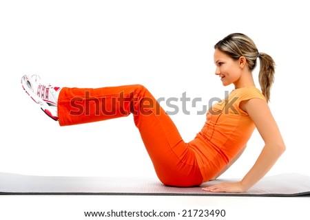 beautiful young woman exercising - stock photo