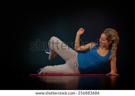 beautiful young woman exercising in the gym - stock photo