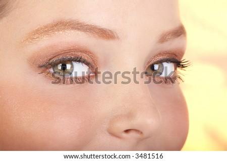 Beautiful young woman face. Close up. - stock photo