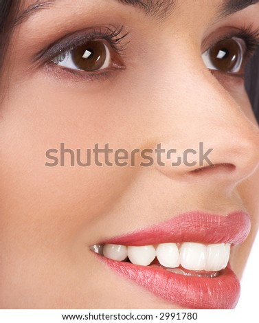 Beautiful young woman face. Close up. Over white background