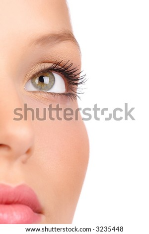 Beautiful young woman face . Over white background - stock photo