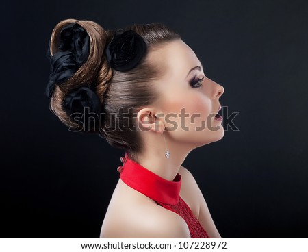 Beautiful young woman face with creative plait hairstyle looking - stock photo