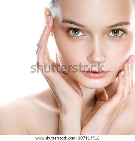 Beautiful young woman face with natural looking makeup - stock photo