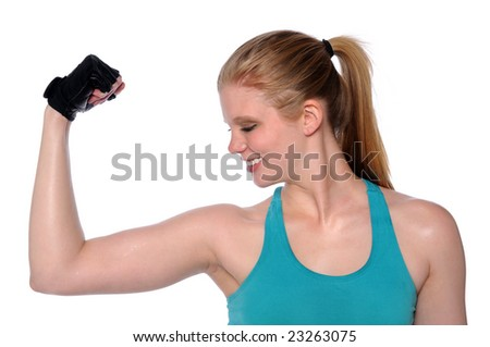 Beautiful young woman flexing arm isolated over a white background - stock photo