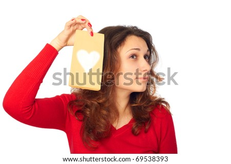 Beautiful young woman getting a pleasant surprise. - stock photo