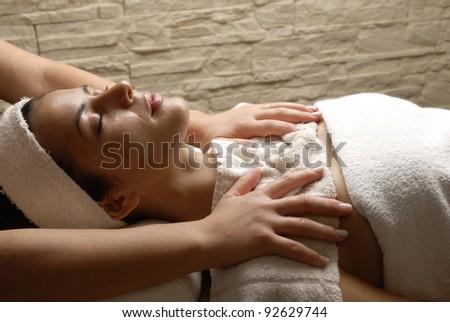 Beautiful young woman getting massage treatment at beauty salon. - stock photo