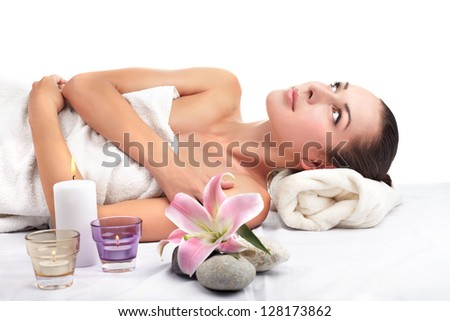 Beautiful young woman getting spa massage - stock photo