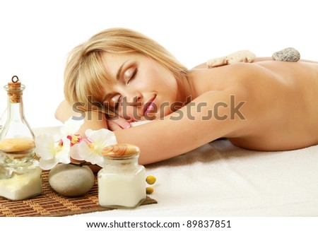 Beautiful young woman getting spa massage isolated on white background