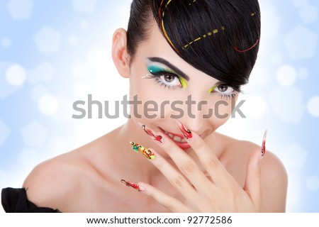 Beautiful young  woman giggles.  Fashion model with nice hair, make-up, manicure. - stock photo