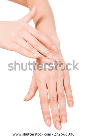Beautiful young woman hands with cream, isolated on white. - stock photo