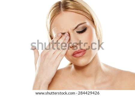 beautiful young woman has pain in the eye - stock photo