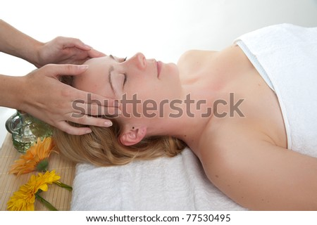 Beautiful young woman having a massage in wellness center - girl in spa