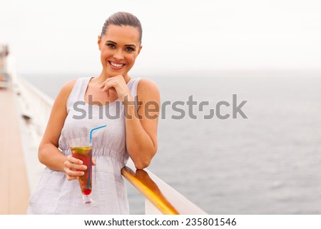 beautiful young woman having cocktail on a cruise ship - stock photo