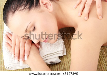 Beautiful young woman having massage