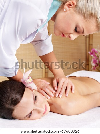 Beautiful young woman having massage.