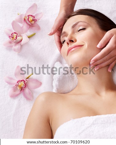 Beautiful young woman having massage. - stock photo