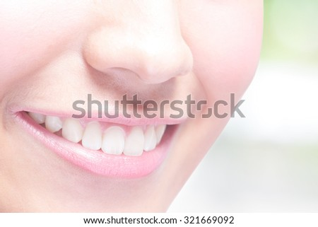 Beautiful young woman health teeth close up and charming smile. with green background, asian beauty - stock photo