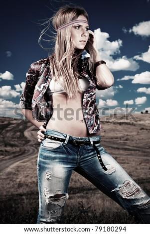 Beautiful young woman hippie posing outdoor. - stock photo