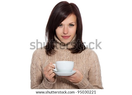 beautiful young woman hold cup of coffee or tea, wearing knitted brown sweater, sensual looking at camera, isolated over white background series photo - stock photo