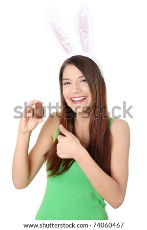 Beautiful young woman holding a chocolate egg - stock photo
