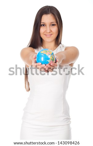 beautiful young woman holding a globe in hands - stock photo