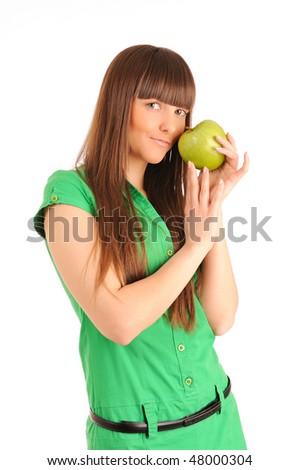 Beautiful young woman holding a green apple, studio shot. - stock photo