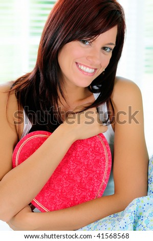 Beautiful Young Woman Holding A Heart Shaped Box Of Chocolates To Her Chest