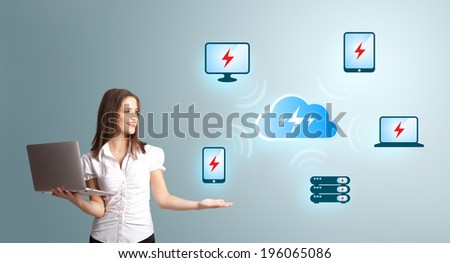 Beautiful young woman holding a laptop and presenting cloud computing network - stock photo