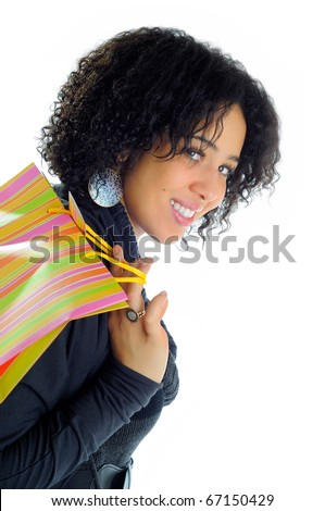 Beautiful Young Woman Holding A Shopping Bag Over her Shoulder - stock photo