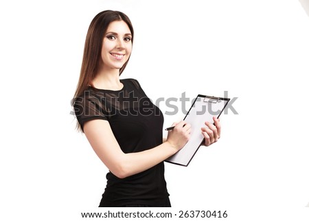 Beautiful young woman holding black folder with white sheet copy space - stock photo