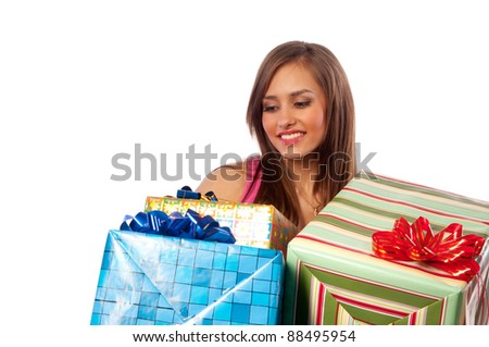 beautiful young woman holding boxes with gifts, isolated background
