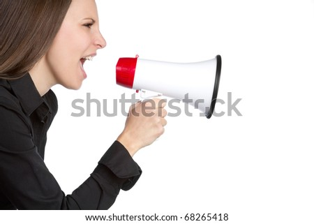Beautiful young woman holding bullhorn - stock photo