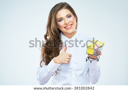 Beautiful young woman holding cart market with presents. isolated white background. - stock photo