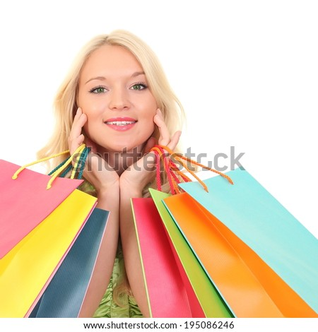 beautiful young woman holding colored shopping bags