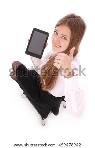 Beautiful young woman holding digital tablet sitting on a chair isolated on white background with soft shadow
