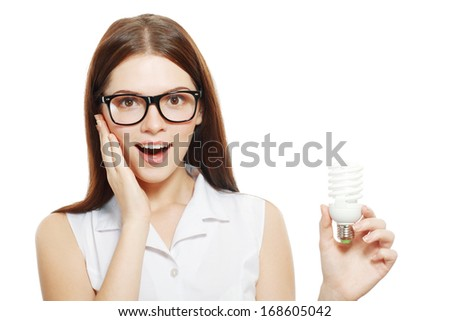 beautiful young woman holding energy saving lamp bulb - stock photo