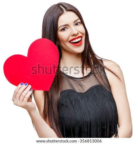Beautiful young woman holding heart shaped valentine card and smiling while standing isolated on white - stock photo