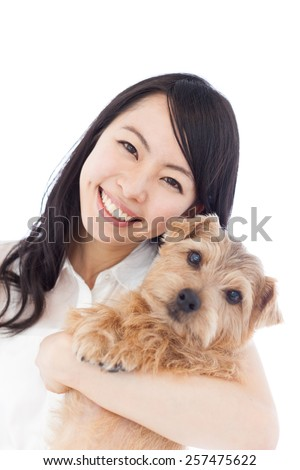 beautiful young woman holding Norfolk Terrier dog, isolated on white background