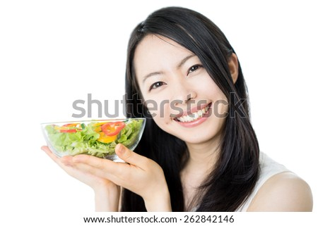 beautiful young woman holding salad, isolated on white background - stock photo