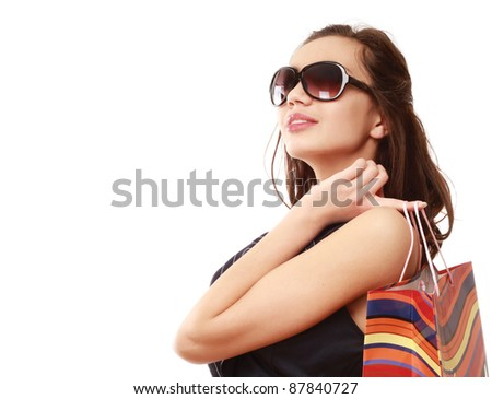 Beautiful young woman holding shopping bag isolated on white background. Side view - stock photo