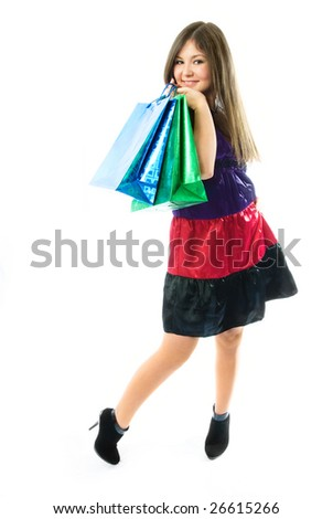 beautiful young woman holding shopping bags against white background - stock photo