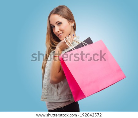 beautiful young woman holding shopping color bags