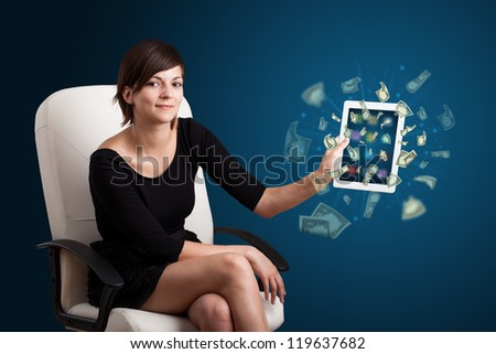 beautiful young woman holding tablet with money