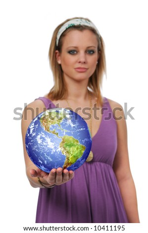 Beautiful young woman holding the earth with selective focus