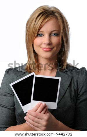 Beautiful young woman holding two blank instant photos
