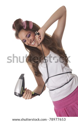Beautiful young woman holds hair dryer