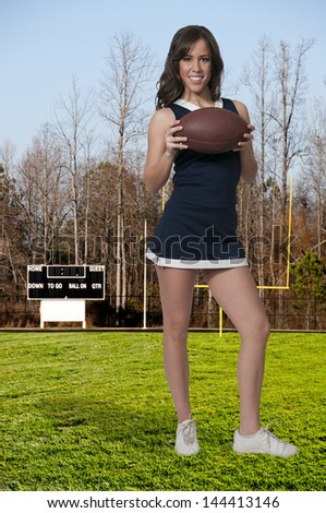 Beautiful young woman in a cheerleading uniform - stock photo