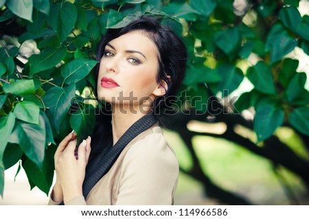 beautiful young woman in a city park - stock photo