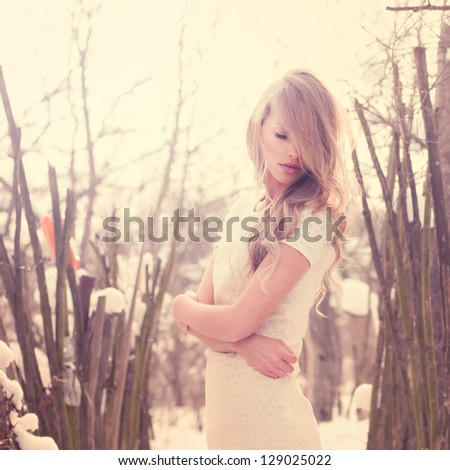 beautiful young woman in a freezing cold winter day - stock photo