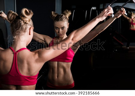 Beautiful young woman in a gym - stock photo
